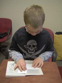 boy reading with Dyslexia Davis® program