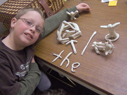 boy with clay Dyslexia Davis® program